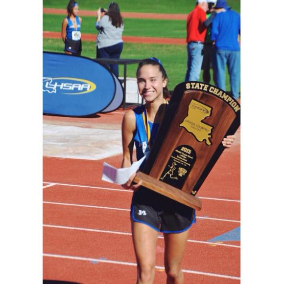 Claire winning State Championship Trophy.jpg