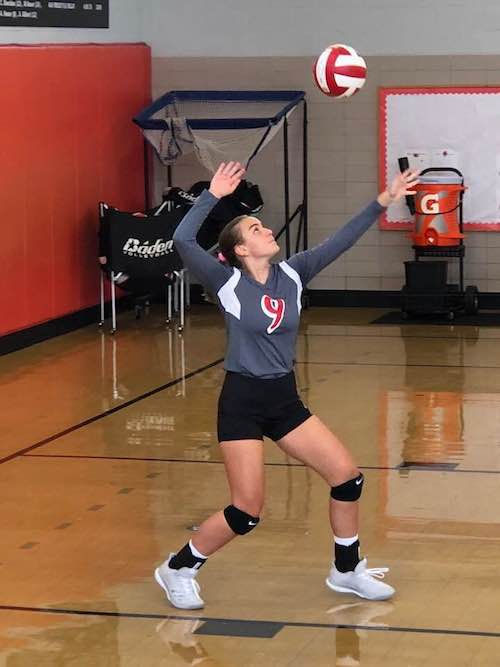 Anita playing volleyball.jpg